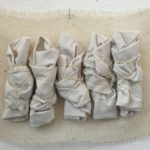 wrapped-white-figures